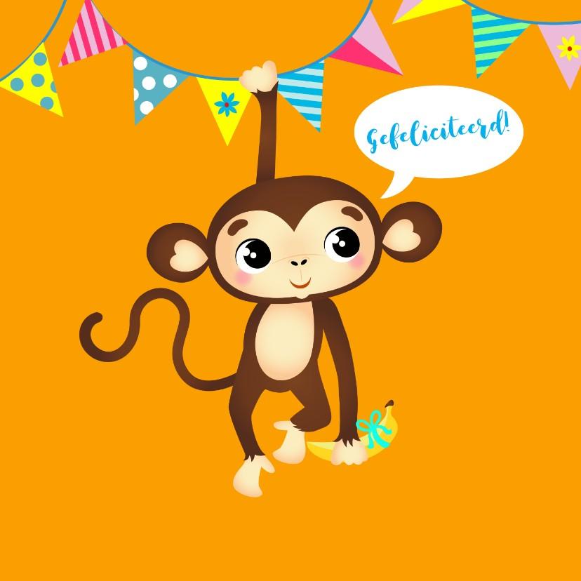 Verjaardagskaarten - Verjaardagskaart vrolijk aapje met banaan en slingers
